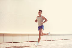 Fitness, workout, sport, lifestyle concept - sportsman running stock images