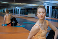 Fitness yoga. Blond woman in gym do fitness exercise Stock Image