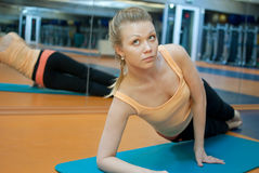 Fitness yoga. Blond woman in gym do fitness exercise Royalty Free Stock Image
