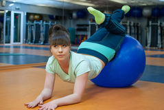 Fitness yoga. Young woman do exercise with ball in gym Stock Photos