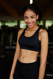 Fitness young beauty in a short top smiling brightly relaxing after fitness training Stock Photos