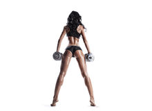 Fitness young brunette woman posing with dumbbells isolated Royalty Free Stock Photos