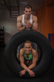 Fitness - a young couple practicing in the small gym stock photos