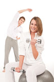 Fitness - Young couple training with weights Royalty Free Stock Photo
