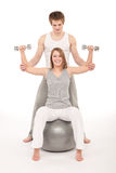 Fitness - Young couple training with weights Stock Photo