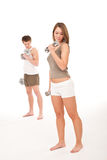 Fitness - Young couple training on white Stock Photos