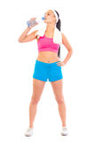 Fitness young girl drinking water from bottle Royalty Free Stock Photos