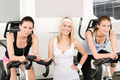 Fitness young girls spinning at gym posing stock photography