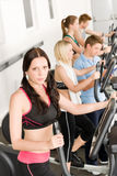 Fitness young group on elliptical cross trainer royalty free stock photos