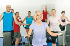 Fitness young group on elliptical cross trainer Royalty Free Stock Photo