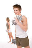 Fitness - Young healthy couple with weights Stock Image