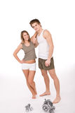 Fitness - Young healthy couple with weights. In sportive outfit on white background Stock Photo
