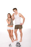 Fitness - Young healthy couple with weights Royalty Free Stock Photography