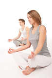 Fitness - Young healthy couple in yoga position Stock Photo