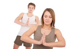 Fitness - Young healthy couple in yoga position Royalty Free Stock Image