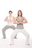 Fitness - Young healthy couple in yoga position Stock Photography