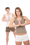 Fitness - Young healthy couple in yoga position Royalty Free Stock Images