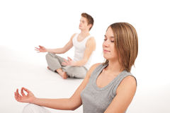 Fitness - Young healthy couple in yoga position Stock Images