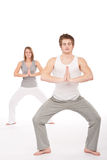 Fitness - Young healthy couple in yoga position Stock Photos