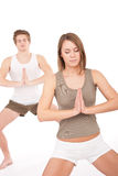 Fitness - Young healthy couple in yoga position Royalty Free Stock Photos