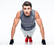 Fitness young man doing push ups Stock Photography