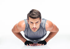Fitness young man doing push ups Stock Images