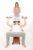 Fitness - young man exercising on bench Royalty Free Stock Photos