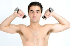 Fitness, Young man lifting weights Royalty Free Stock Photography