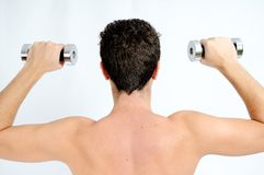 Fitness, Young man lifting weights Stock Images