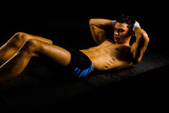 Fitness young man working abs Royalty Free Stock Images