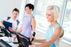 Fitness young people on treadmill cardio workout Royalty Free Stock Photography