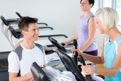 Fitness young people on treadmill cardio workout Royalty Free Stock Photo