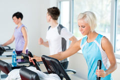 Fitness young people on treadmill running exercise Stock Photography