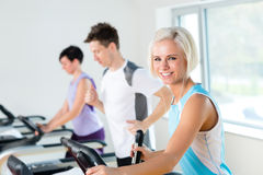 Fitness young people on treadmill running exercise Royalty Free Stock Photos