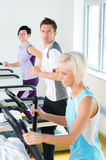 Fitness young people on treadmill running exercise Stock Image
