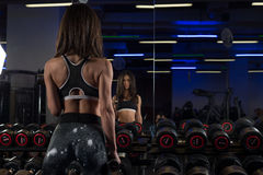 Fitness young sexy girl in the gym doing exercises Royalty Free Stock Image