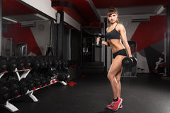 Fitness young sexy girl in the gym Stock Images