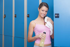 Fitness young smiling woman resting in blue dressing room Royalty Free Stock Photography