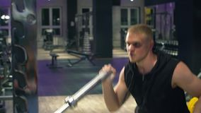 Fitness young strong man in the gym. Fitness, sport, exercising, training and lifestyle concept stock footage