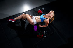 Fitness young sweaty girl with a sports body in the gym sexually stock images