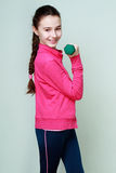 Fitness. Young teenage girl doing workout with dumbbells Royalty Free Stock Images