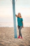 Fitness young woman on beach in the evening Stock Photography