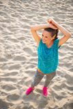 Fitness young woman on beach Stock Photo