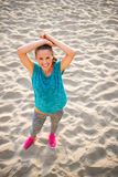 Fitness young woman on beach Royalty Free Stock Photos
