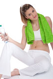 Fitness – Young woman with bottle of water Stock Photography