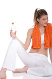 Fitness – Young woman with bottle of water Royalty Free Stock Photography