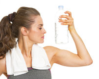 Fitness young woman with bottle of water showing biceps Stock Image