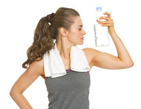 Fitness young woman with bottle of water showing biceps Royalty Free Stock Photo