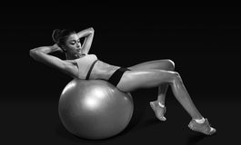 Fitness young woman doing abdominal crunch on fitness ball Royalty Free Stock Image