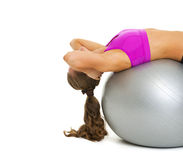Fitness young woman doing abdominal crunch on fitness ball. Isolated on white Stock Images